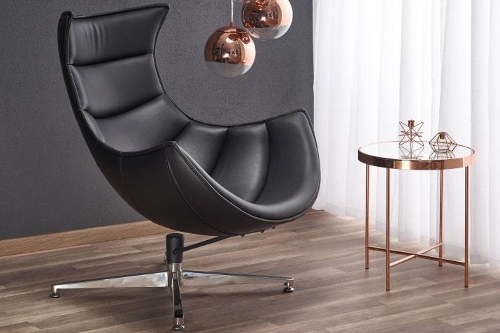 Nowoczesny czarny fotel skórzany na obrotowej podstawie Luxor Halmar.