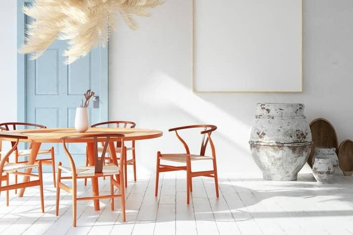 Designerskie drewniane krzesło Wicker z plecionym siedziskiem.