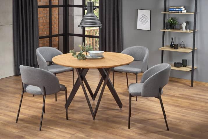 """Stylowe szare krzesła tapicerowane """"muszelka"""" na metalowych nogach."""