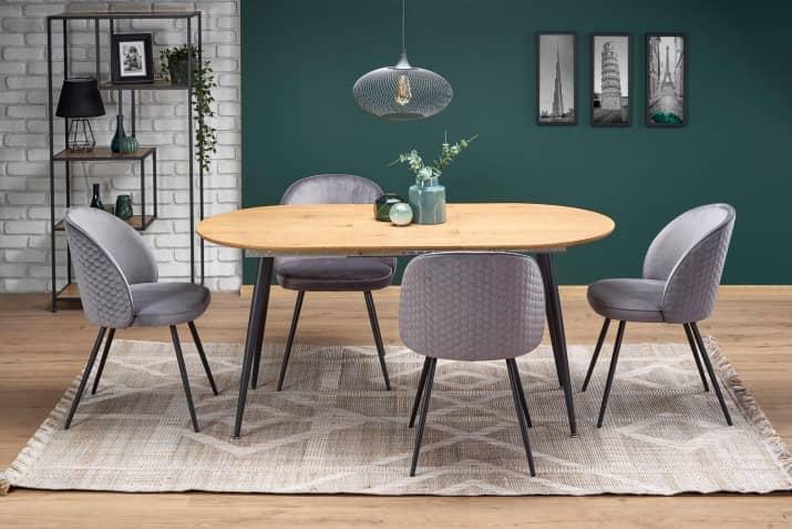 Szare krzesła tapicerowane K395 w aranżacji ze stołem industrialnym.